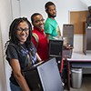 Danica Forestal and NSBE peers with donated computers