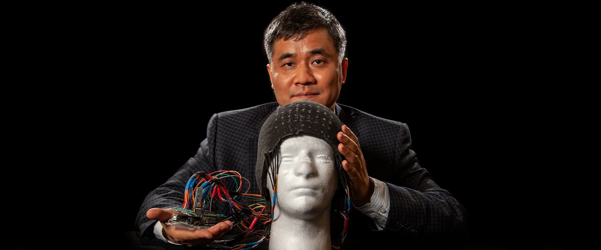Changchun Zeng, an associate professor of engineering at the FAMU-FSU College of Engineering and a researcher at Florida State's High-Performance Materials Institute, with the prototype helmet foam that stemmed from his research.