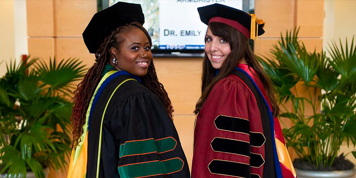 Two female PhD students graduating