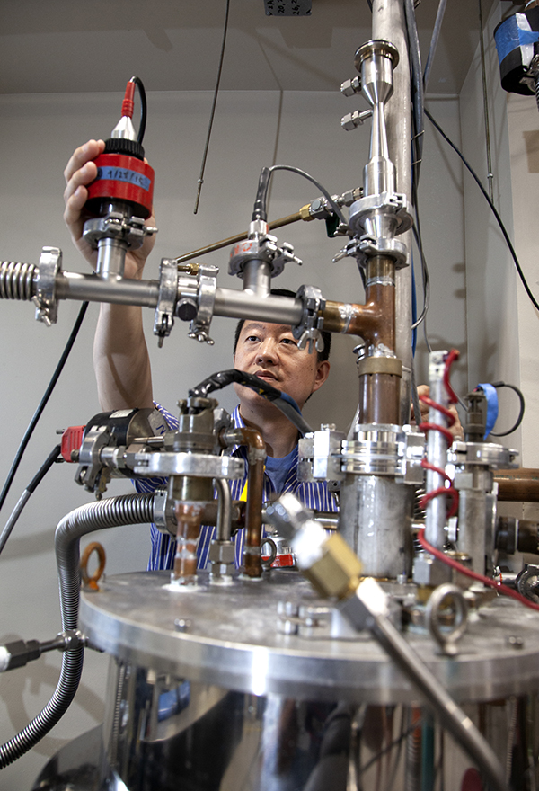 Wei Guo, PhD in his cryogenics lab