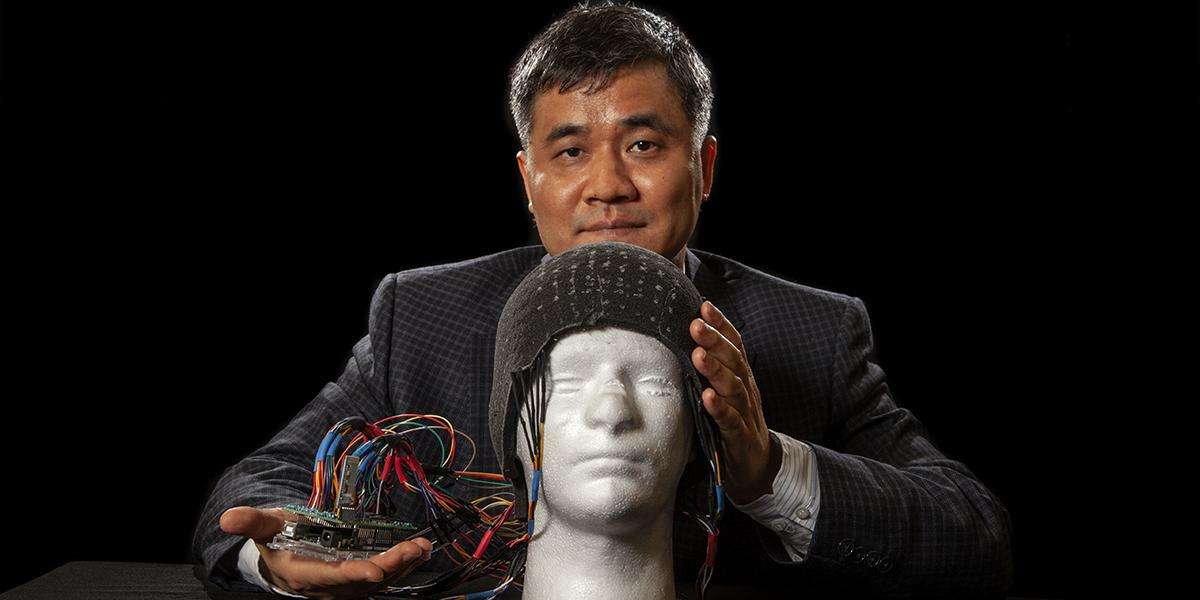 Dr. Chad Zeng and his prototype helmet foam