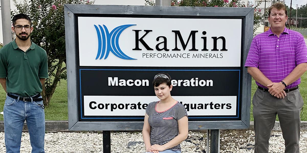 Ali Mir, Jillian Jones and Jason Maxwell in front of the KaMin sign
